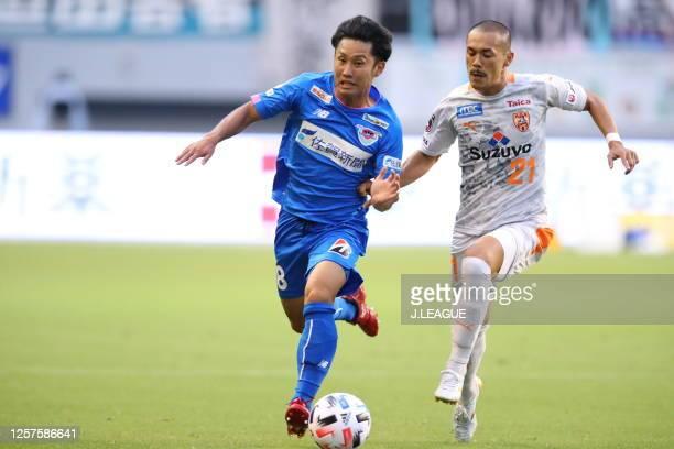 Ryoya Morishita of Sagan Tosu and Ryo Okui of Shimizu S-Pulse compete for the ball during the J.League Meiji Yasuda J1 match between Sagan Tosu and...