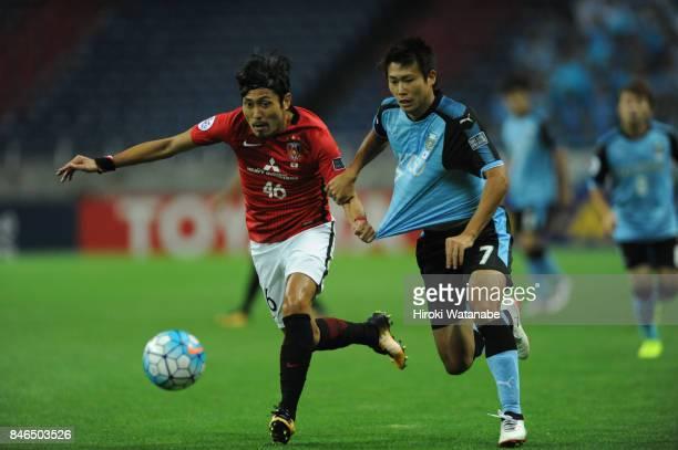 Ryoya Moriwaki of Urawa Red Diamonds and Shintaro Kurumaya of Kawasaki Frontale compete for the ball during the AFC Champions League quarter final...