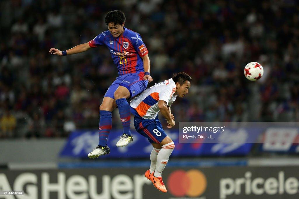Ryoya Ogawa of FC Tokyo and Kei Koizumi of Albirex Niigata compete for the ball during the J.League J1 match between FC Tokyo and Albirex Niigata at Ajinomoto Stadium on July 30, 2017 in Chofu, Tokyo, Japan.