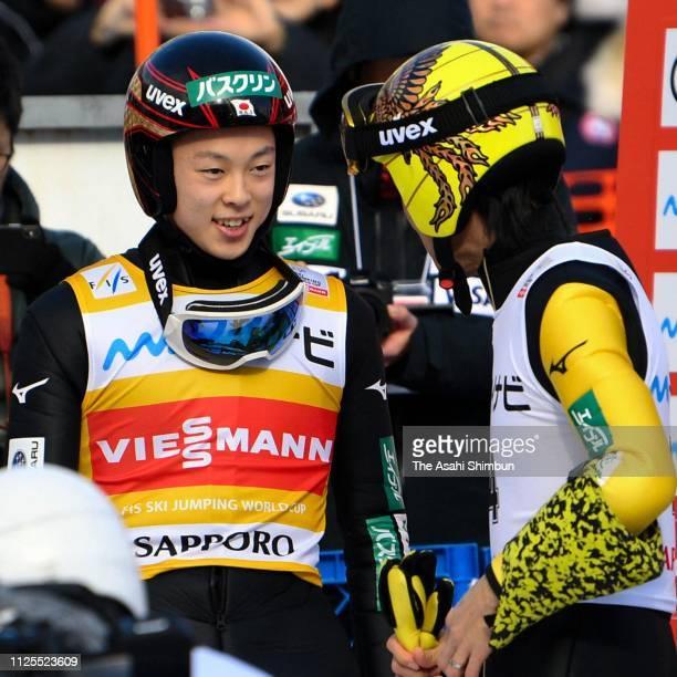Ryoyu Kobayashi and Noriaki Kasai of Japan talk after competing on day two of the FIS Ski Jumping World Cup Sapporo at Okurayama Jump Stadium on...