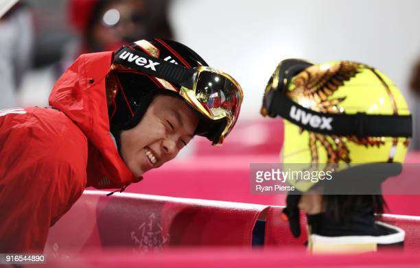 Ryoyu Kobayashi of Japan and Noriaki Kasai of Japan in discussion during the Ski Jumping Men's Normal Hill Individual Final on day one of the...
