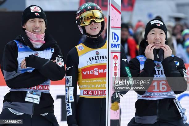 Ryoyu Kobayashi of Japan and team mates Junshiro Kobayashi and Ito Daiki wait for the result of the Final Round on day 4 of the 67th FIS Nordic World...
