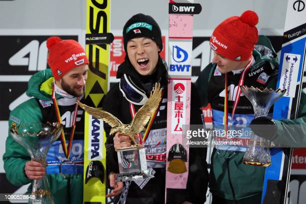 Ryoyu Kobayashi of Japan celebrates after winning the FIS Nordic World Cup Four Hills Tournament with second placed Markus Eisenbichler of Germany...