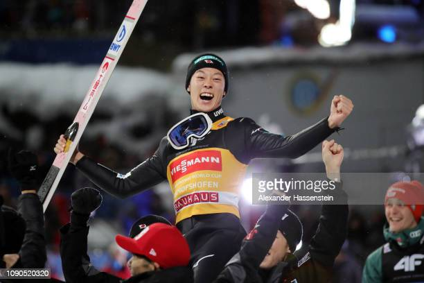 Ryoyu Kobayashi of Japan celebrates with his team mates after winning the FIS Nordic World Cup Four Hills Tournament at PaulAusserleitner Jumping...