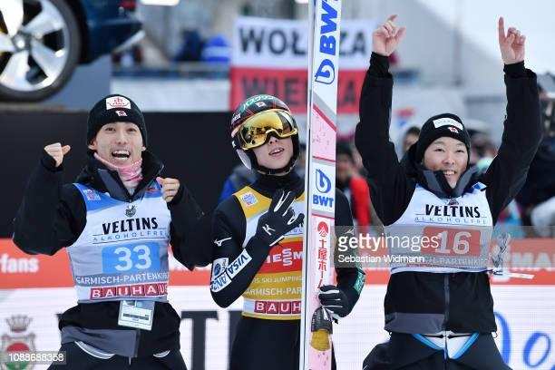 Ryoyu Kobayashi of Japan celebrates with team mates Junshiro Kobayashi and Ito Daiki during the Final Round on day 4 of the 67th FIS Nordic World Cup...