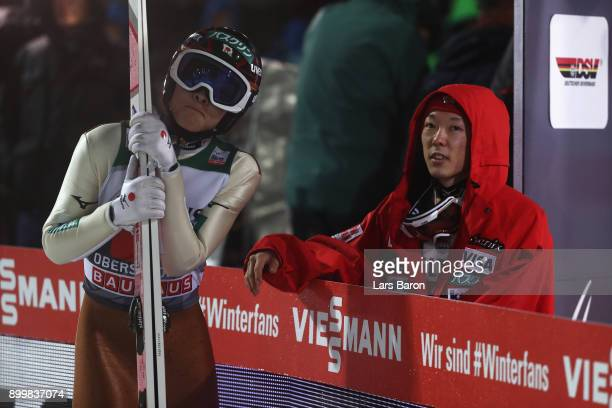 Ryoyu Kobayashi of Japan looks on with his brother Junshiro Kobayashi of Japan competes in the FIS Nordic World Cup on day 2 of the Four Hills...