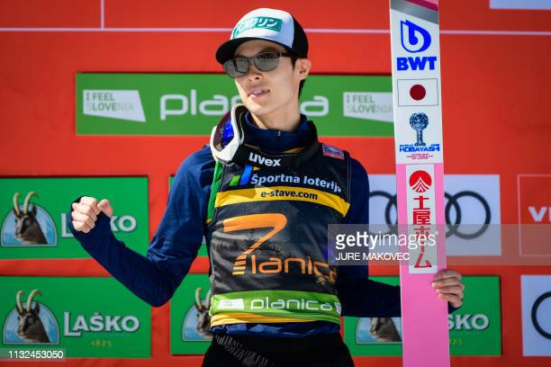 Ryoyu Kobayashi of Japan poses for photos after winning the special Planica 7 clasification in Planica Slovenia on March 24 2019
