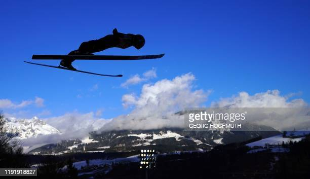Ryoyu Kobayashi of Japan soars through the air during the training jump at the fourth stage of the Four Hills Ski Jumping tournament in...