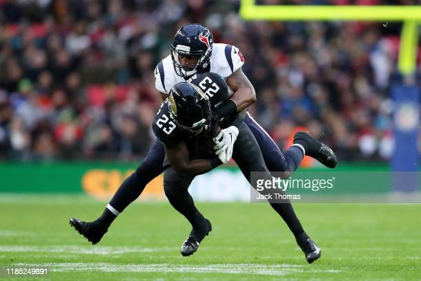 Ryquell Armstead of the Jacksonville Jaguars is tackled by Zach Cunningham of the Houston Texans during the NFL match between the Houston Texans...