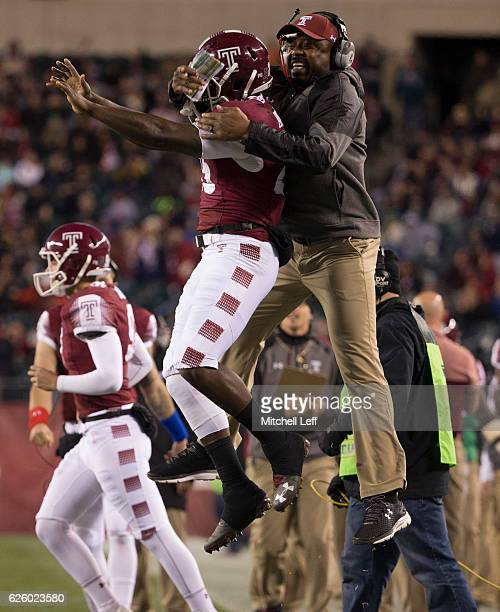 Ryquell Armstead of the Temple Owls celebrates with wide receivers coach Frisman Jackson after scoring a touchdown in the first quarter against the...