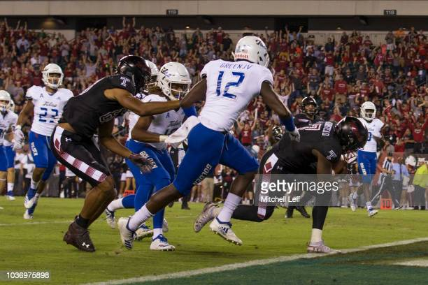 Ryquell Armstead of the Temple Owls runs past Allie Green IV of the Tulsa Golden Hurricane to score a touchdown in the second quarter at Lincoln...