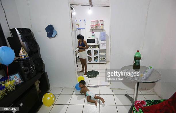 Ryquelme Kauan who was born with microcephaly attempts to crawl by his mother Avila before the start of his one year birthday party at their house on...
