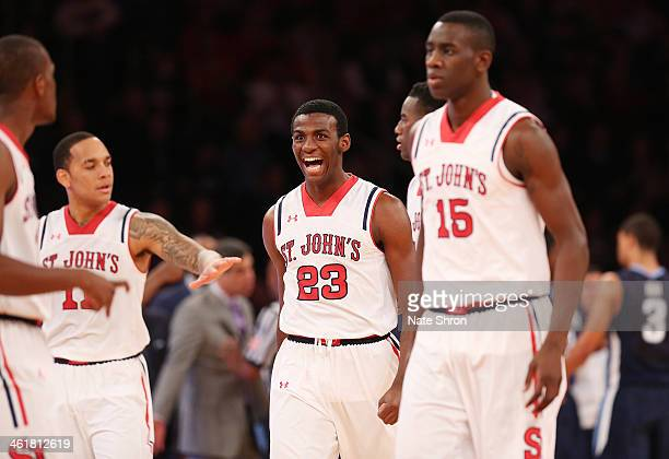 Rysheed Jordan of the St John's Red Storm celebrates with teamates after a play during the game against the Villanova Wildcats at Madison Square...