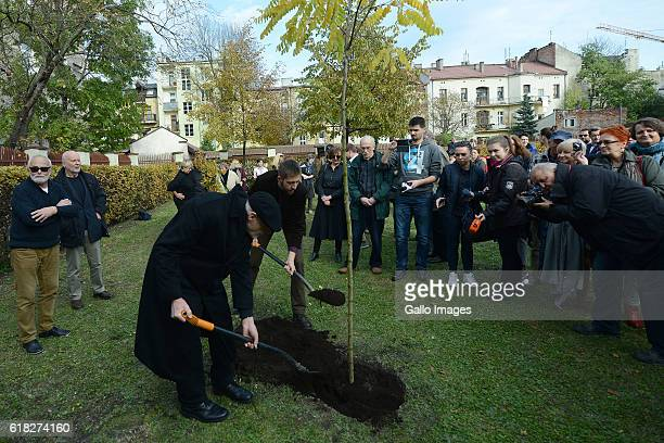 Ryszard Krynicki and Jakub Kornhauser attend the ceremony of planting Wislawa Szymborskaâs acacia on October 24 2016 near Dworek Lowczego in Krakow...