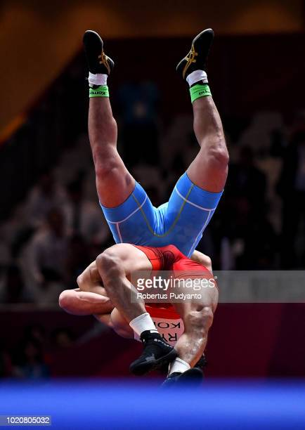 Ryu Hansu of Korea fights against Kebispayev Almat of Kazakhstan during Men's Greco Roman 67 kg final match on day three of the Asian Games on August...