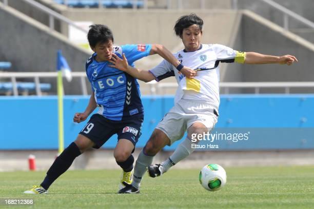 Ryu Okada of Avispa Fukuoka and Kosuke Onose of Yokohama FC compete for the ball during the JLeague second division match between Yokohama FC and...