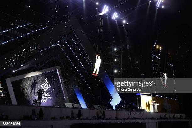Ryu Seungmin a member of Athletes Commission of the International Olympic Committee is suspended in the air while carrying the Olympic torch to...