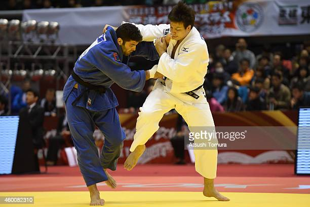 Ryu Shichinohe of Japan and Or Sasson of Israel compete in Men's 100kg during Judo Grand Slam Tokyo 2014 at Tokyo Metropolitan Gymnasium on December...