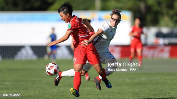Ryu Song Kim of the Korea DPR struggles for the ball with Julia Pollak of Germany during the FIFA U17 Women's World Cup Uruguay 2018 group C match...
