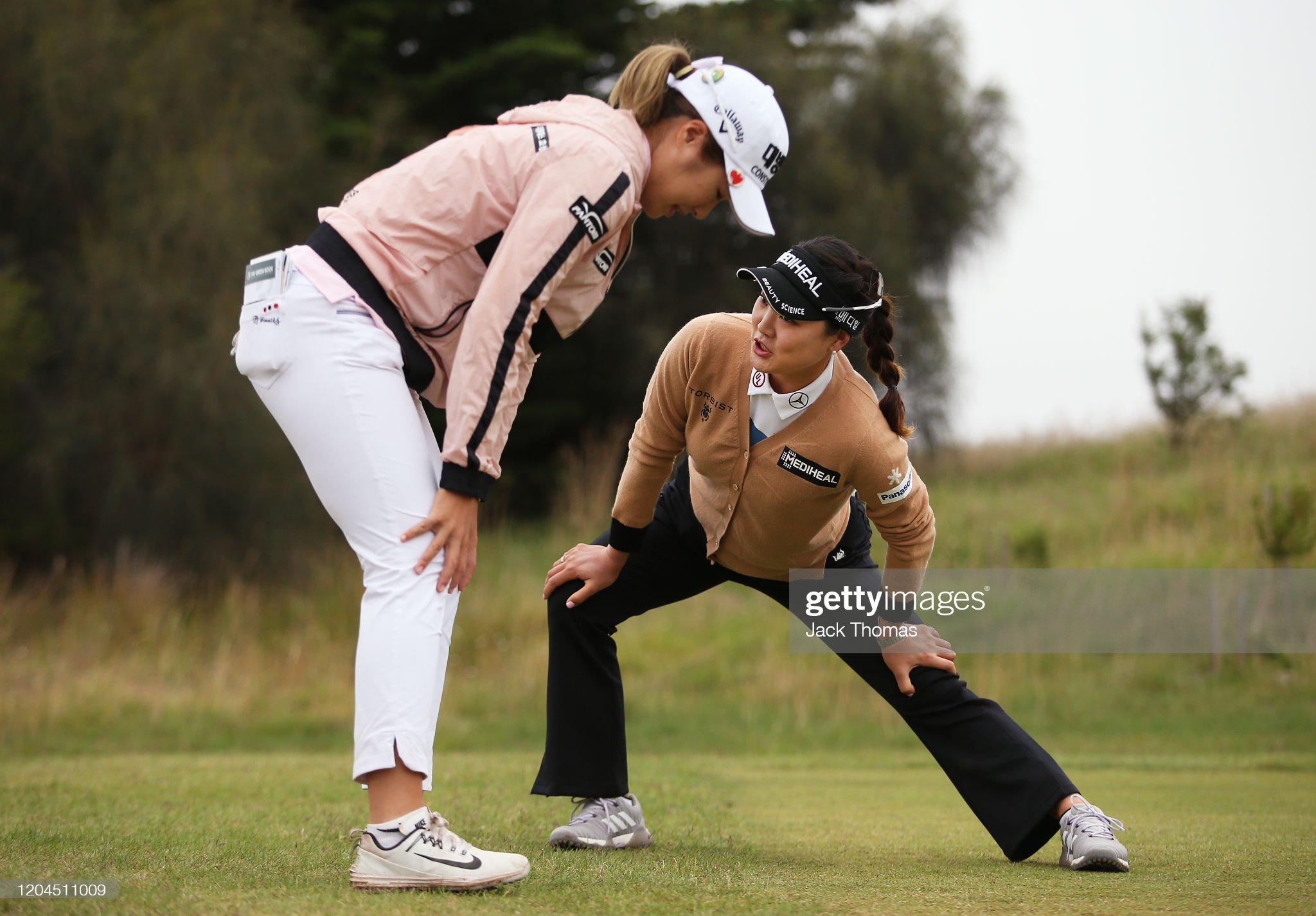 https://media.gettyimages.com/photos/ryu-soyeon-of-south-korea-and-jeongeun-lee6-of-south-korea-stretch-on-picture-id1204511009?s=2048x2048