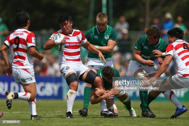 Ryuga Hashimoto of Japan is tackled by the Ireland defence during the World Rugby Under 20 Championship 11th Place playoff match between Ireland and...