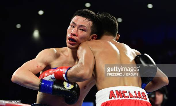 Ryuichi Funai of Japan fights Jerwin Ancajas of the Philippines during their 12round Super Flyweight IBF World Title fight in Stockton California on...