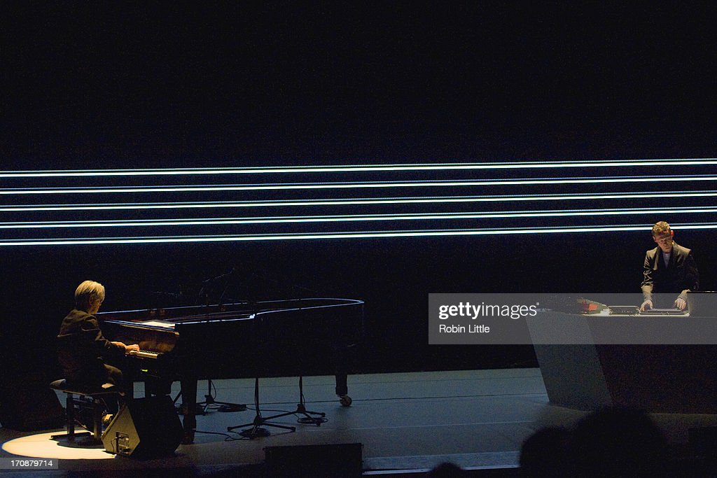 Ryuichi Sakamoto and Alva Noto perform on stage at the Royal Festival Hall on June 19, 2013 in London, England.