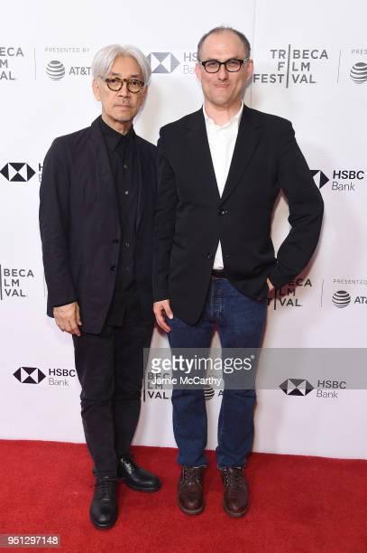 "Ryuichi Sakamoto and Stephen Nomura Schible attend the screening of ""Ryuichi Sakamoto: Coda"" during the 2018 Tribeca Film Festival at Cinepolis..."