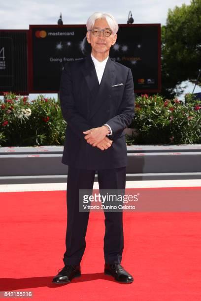 Ryuichi Sakamoto walks the red carpet ahead of the 'Ryuichi Sakamoto Coda' screening during the 74th Venice Film Festival at Sala Grande on September...