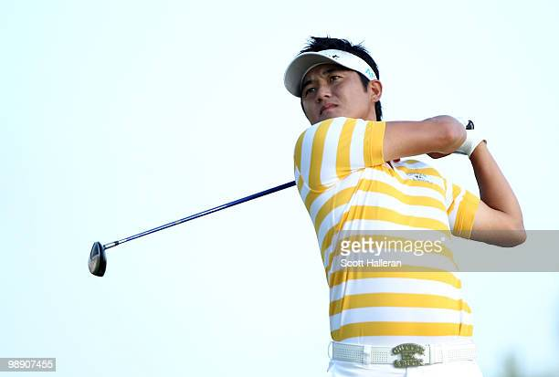 Ryuji Imada of Japan hits his tee shot on the fourth hole during the second round of THE PLAYERS Championship held at THE PLAYERS Stadium course at...