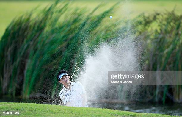 Ryuji Imada of Japan plays his second shot from a bunker on the eighth hole during round one of the Puerto Rico Open presented by Banco Popular at...