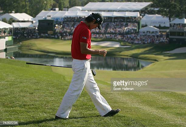 Ryuji Imada reacts to hitting a shot in the water on the first playoff hole with Zach Johnson during the final round of the ATT Classic at TPC...