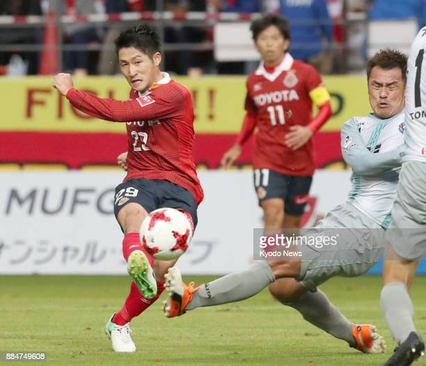 Ryuji Izumi of Nagoya Grampus shoots in the first half of a 00 draw with Avispa Fukuoka in the JLeague second division playoff final at Toyota...