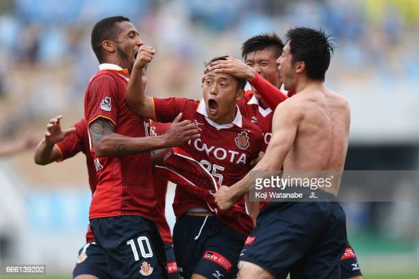 Ryuji Sugimoto of Nagoya Grampus celebrates scoring his side's second goal with his team mates during the JLeague J2 match between Nagoya Grampus and...