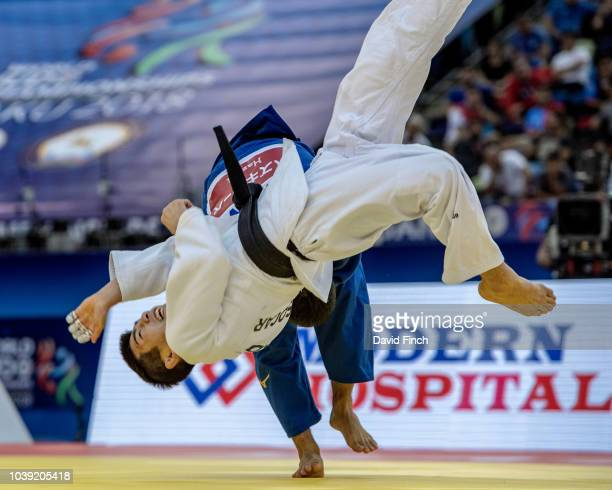 Ryuju Nagayama of Japan throws Harim Lee of South Korea without a score eventually winning the contest by an ippon to take the u60kg bronze medal...