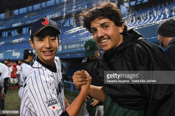 Ryuki Watarai of Japan and Blake Cavill of Australia pose for photograph during the closing ceremony following the the U15 Asia Challenge Match...