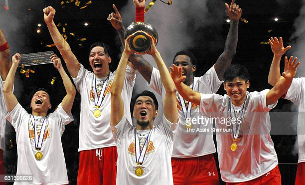 Ryumo Ono of Chiba Jets lifts the trophy after winning the 92nd Emperor's Cup All Japan Men's Basketball Championship final at Yoyogi National...