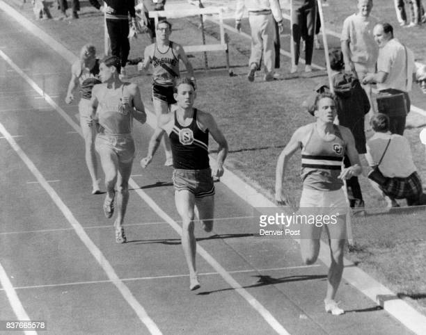 Ryun Jaunts Home Third in Big Eight 880 Trial Kansas Jim Ryun world record holder in the mile looks over his right shoulder to check his position as...