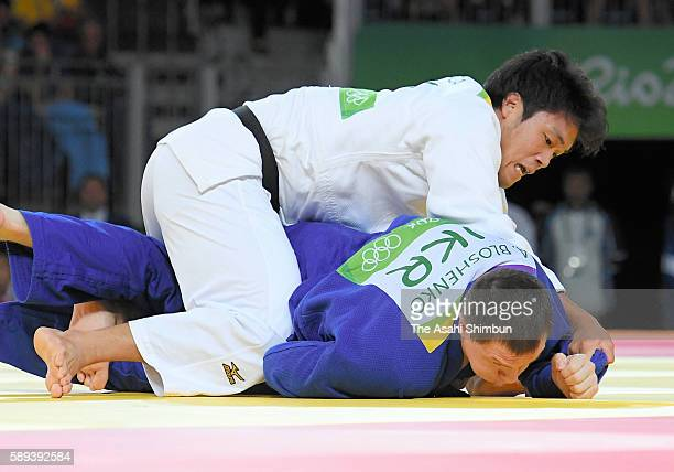 Ryunosuke Haga of Japan and Artem Bloshenko of Ukraine compete in the Men's 100kg bronze medal B contest on Day 6 of the 2016 Rio Olympics at Carioca...