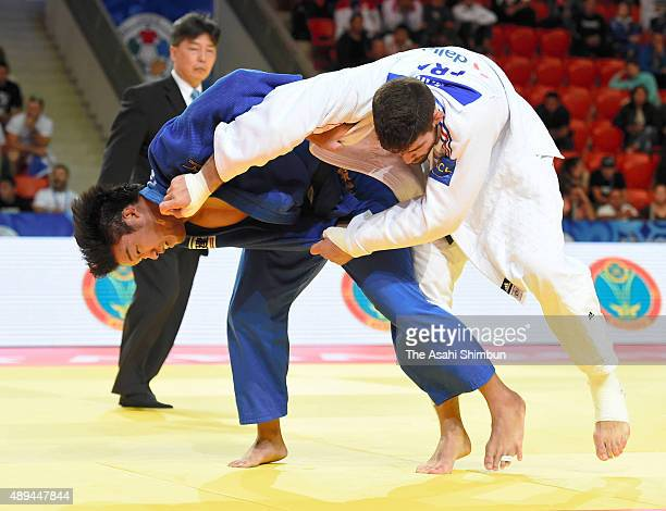 Ryunosuke Haga of Japan and Cyrille Maret of France compete in the Men's 100kg semifinal during the 2015 Astana World Judo Championships at the Alau...