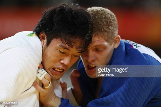 Ryunosuke Haga of Japan competes against Rafael Buzacarini of Brazil during the men's 100kg elimination round judo contest on Day 6 of the 2016 Rio...