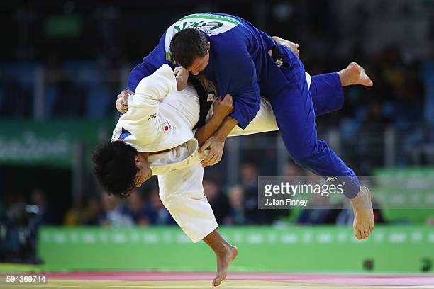 Ryunosuke Haga of Japan throws Artem Bloshenko of Ukraine in the men's 100kg bronze medal contest during the Judo on day six on August 11 2016 in Rio...