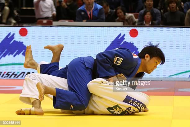 Ryunosuke Haga of Japan throws Elmar Gasimov of Azerbaijan for ippon in the Men's 100kg preliminary at Tokyo Metropolitan Gymnasium on December 6...