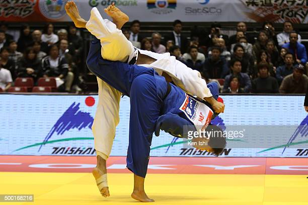 Ryunosuke Haga of Japan throws Elmar Gasimov of Azerbaijan for ippon in the Men's 100kg preliminary at Tokyo Metropolitan Gymnasium on December 6...