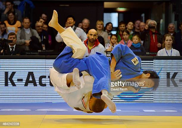 Ryunosuke Haga of Japan throws KarlRichard Frey with uchimata for ippon on his way to the u100kg gold medal during the Dusseldorf Grand Prix at the...