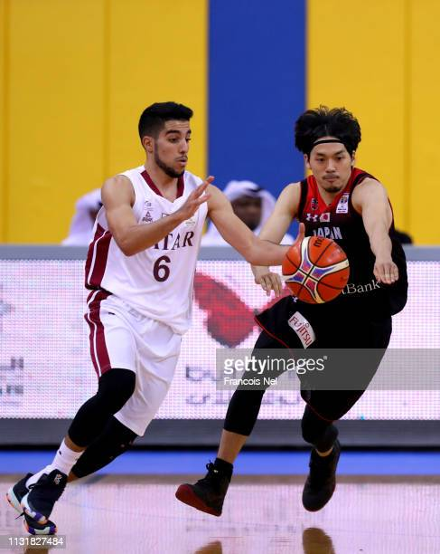 Ryusei Shinoyama of Japan competes for the ball with Moustafa Essam Fouda of Qatar during the FIBA Basketball World Cup 2019 Asian Qualifier between...