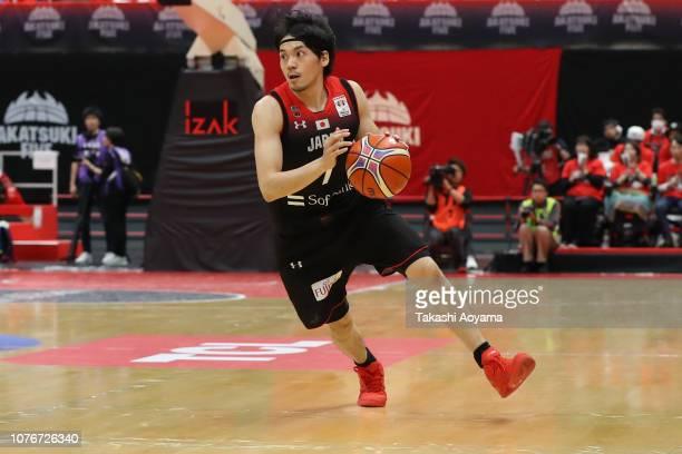 Ryusei Shinoyama of Japan dribbles the ball during the FIBA World Cup Asian Qualifier Group F match between Japan and Kazakhstan at Toyama City...