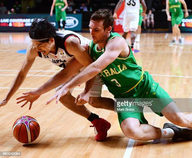 Ryusei Shinoyama of Japan fights for a ground ball with Cameron Gladden of Australia during the FIBA 2019 Asia Cup Qualifier match between the...