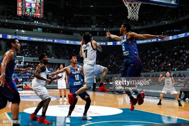 Ryusei Shinoyama of team Japan leaps to the basket against Gabe Norwood of team Philippines The Philippine and Japanese basketball team met at the...