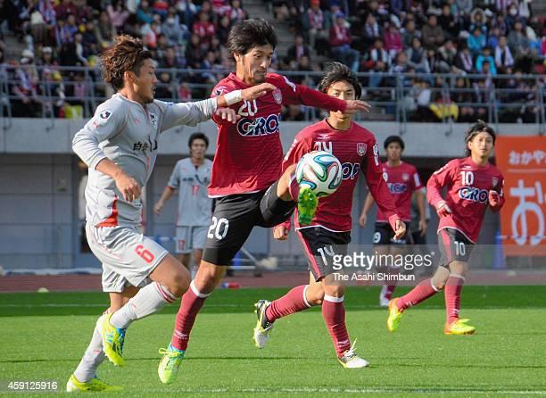 Ryusuke Senoo of Fagiano Okayama and Kojiro Shinohara of Roasso Kumamoto compete for the ball during the J.League second division match between...